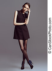 high fashion - Vogue shot of a female brunette model posing...