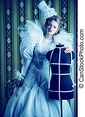 high fashion - Beautiful fashion model in the refined white...