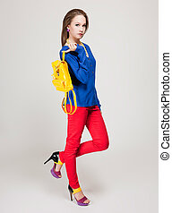 High fashion. - Cool young beauty posing in very fashionable...