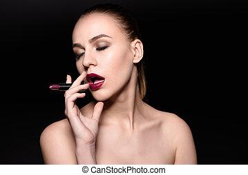 High Fashion Woman Portrait. Model Smoking lipstick, Beauty Girl with Dark Violet Lips