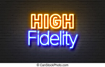 High fidelity neon sign on brick wall background. - High...