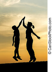 High five at sunset.