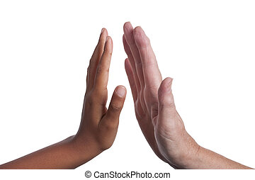 High five - Young dark skinned mixed race girls hand, giving...