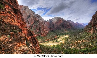 High ground timelapse at Zion, Utah as traffic flows far...