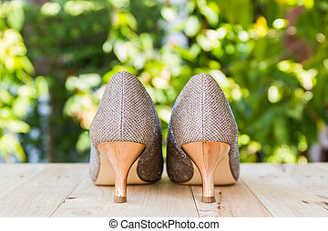 High heel of golden shoes. - High heel of golden shoes on...