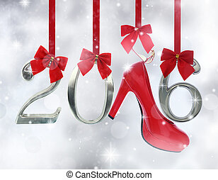 High heel shoe and 2016 number hanging on red ribbons in a glittery background