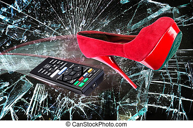 High heel shoe and remote through glass.