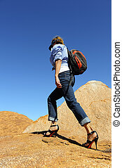 High heel walking outback - Attractive lady in jeans,...