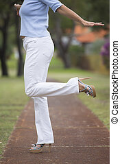High Heels balancing woman park outdoor - Woman in white...