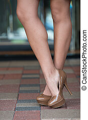 High heels on paver blocks