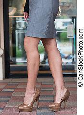 High heels on paver blocks