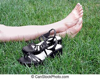 high heels and bare feet on green grass
