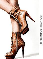 high heels - female legs in brown high heel platform shoes,...