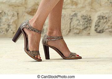 high heels - closeup of woman legs with luxury high heels