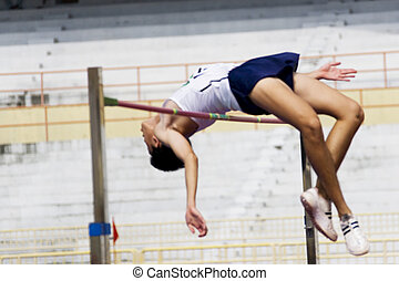 High Jump Action (Blurred) - Image of a high jumper in...