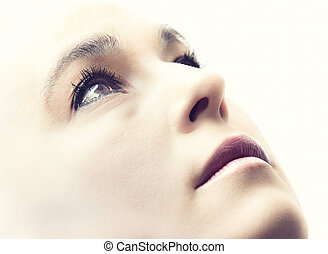 High key portrait of a woman with empty expression on her face