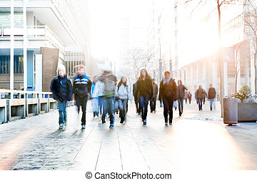 High key image of a group of school kids walking towards the camera on a cold winter day
