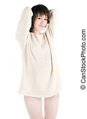 High key shot of model in long white jumper