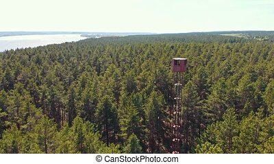 High landmark tower building in the forest - vast view. ...