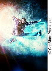high leap - Modern young man dancer dancing at studio.