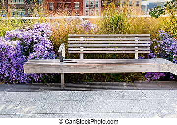 High Line Park Bench - Relaxing wooden bench surrounded by ...