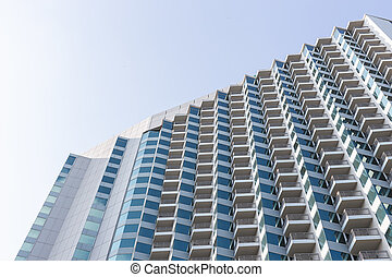High modern hotel building on blue sky background