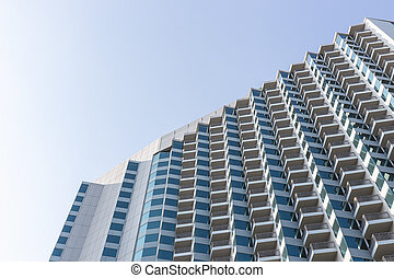 High modern hotel building on blue sky