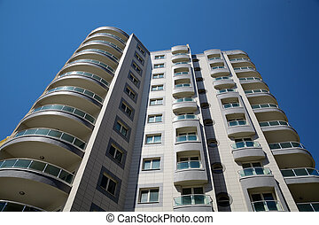 high modern residential building on a background blue sky