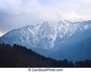 High mountain covered by white snow in Japan.