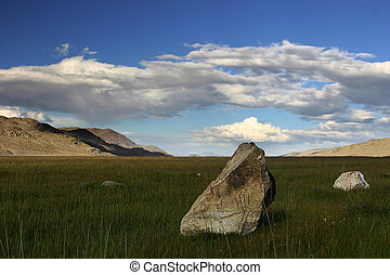 stone in the high mountain steppe and cloudy sky