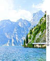 High mountains and walkway on the shore, Lake Garda,Italy, Europe