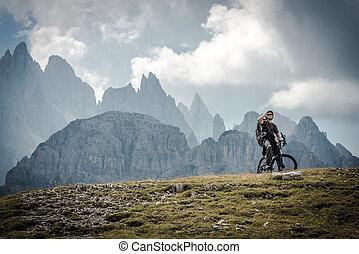 High Mountains Bike Ride. Caucasian Sportsman on the Ride...