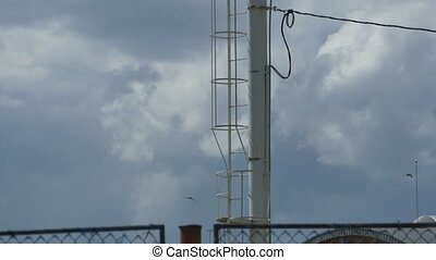 High Pole Antenna and Reflector - Tilt shot on a high pol...