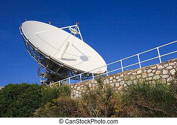 High Power Satellite Antenna Against Clear Blue Sky