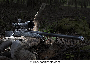 High powered weapon in the forest