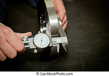 High precision measurement tool in a mechanics plant. Focus on the dial.