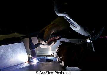 High precision welding - Welder, repairing a large steel ...
