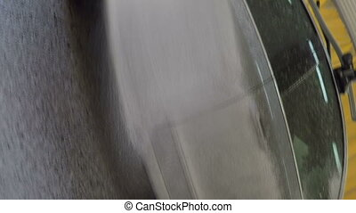 High pressure washer cleaning car spraying detergent foam on...