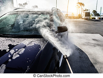 High-pressure washing car. Car washing under the open sky.