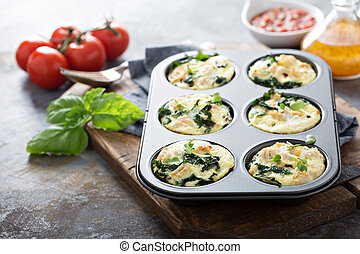 High protein egg muffins with kale and ground turkey in a ...