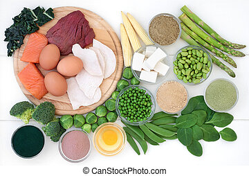 High protein food collection with meat, fish, dairy, legumes, supplement powders and soy bean curd. Hgh in dietary fibre, antioxidants and vitamins. Top view on rustic wood background.