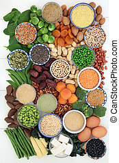High protein health food collection with legumes, fruit, vegetables, bean curd, dairy, supplement powders, grains, nuts and seeds. Hgh in dietary fibre, antioxidants and vitamins. Top view.