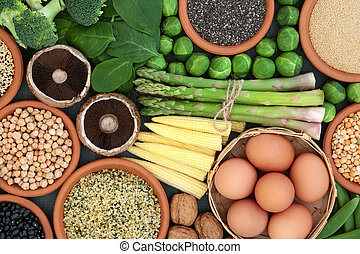 High protein source health food with fresh vegetables, legumes, nuts, grains and seeds, high in dietary fibre, antioxidants and vitamins. Top view.