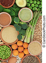 High protein health food with fresh vegetables, dried fruit, legumes, nuts, dairy, supplement powders, grains and seeds. High in dietary fibre, antioxidants and vitamins.