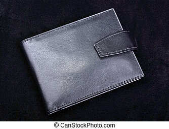 High quality leather wallet isolated on black velvet background. Studio shot.