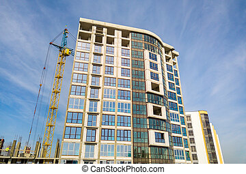 High residential apartment building under construction. Real estate development.