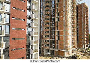 High residential apartment buildings under construction. Real estate development.