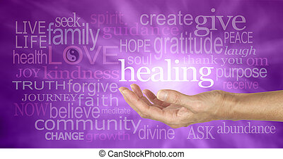 Healer's outstretched open hand surrounded by random wise healing words on a purple background and white energy formation flowing outwards from the hand