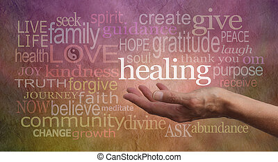 Healer's outstretched open hand surrounded by random wise healing words on a rustic stone effect background