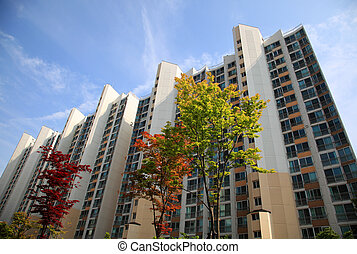 high rise apartment building with trees